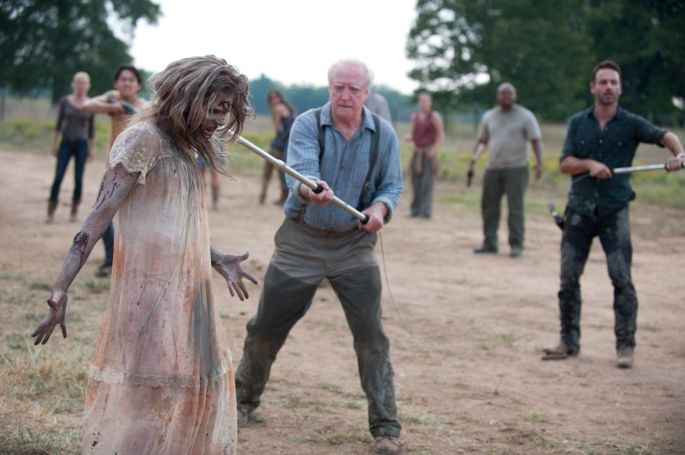 (Foreground) Hershel Greene (Scott Wilson) - (Background L-R) Andrea (Laurie Holden), Glenn (Steven Yeun), Lori Grimes (Sarah Wayne Callies), Carol (Melissa Suzanne McBride), T-Dog (Robert 'IronE' Singleton) and Rick Grimes (Andrew Lincoln) - The Walking Dead - Season 2, Episode 7 - Photo Credit: Gene Page/AMC